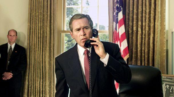 PHOTO: President George W. Bush speaks by telephone from the Oval Office at the White House in Washington, D.C., with New York City Mayor Rudolph Giuliani and New York Governor George Pataki, Sept. 13, 2001. (Doug Mills/AP)