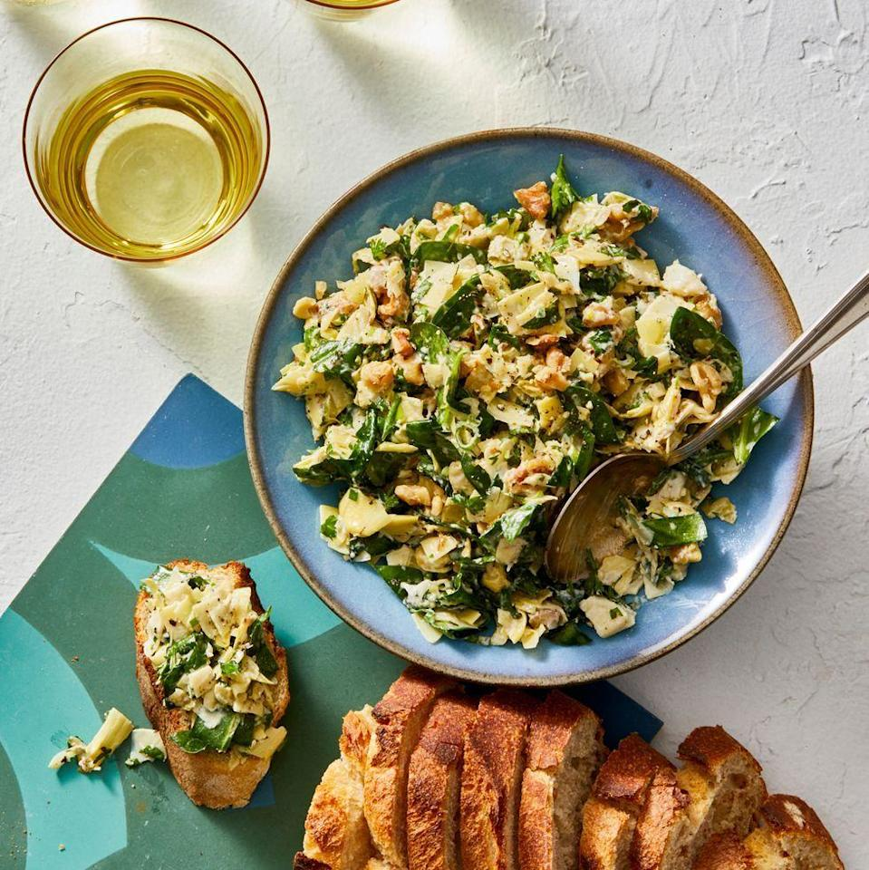 "<p>Everyone at the picnic will thank you for bringing this fan-favorite app. We lightened up this version with fresh herbs and walnuts.</p><p><em><a href=""https://www.goodhousekeeping.com/food-recipes/a28497576/best-ever-spinach-and-artichoke-dip-recipe/"" rel=""nofollow noopener"" target=""_blank"" data-ylk=""slk:Get the recipe for Best Ever Spinach and Artichoke Dip »"" class=""link rapid-noclick-resp"">Get the recipe for Best Ever Spinach and Artichoke Dip »</a></em></p>"