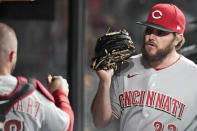 Cincinnati Reds starting pitcher Wade Miley, right, is congratulated by catcher Tucker Barnhart in the dugout in the sixth inning of a baseball game against the Cleveland Indians, Friday, May 7, 2021, in Cleveland. (AP Photo/Tony Dejak)