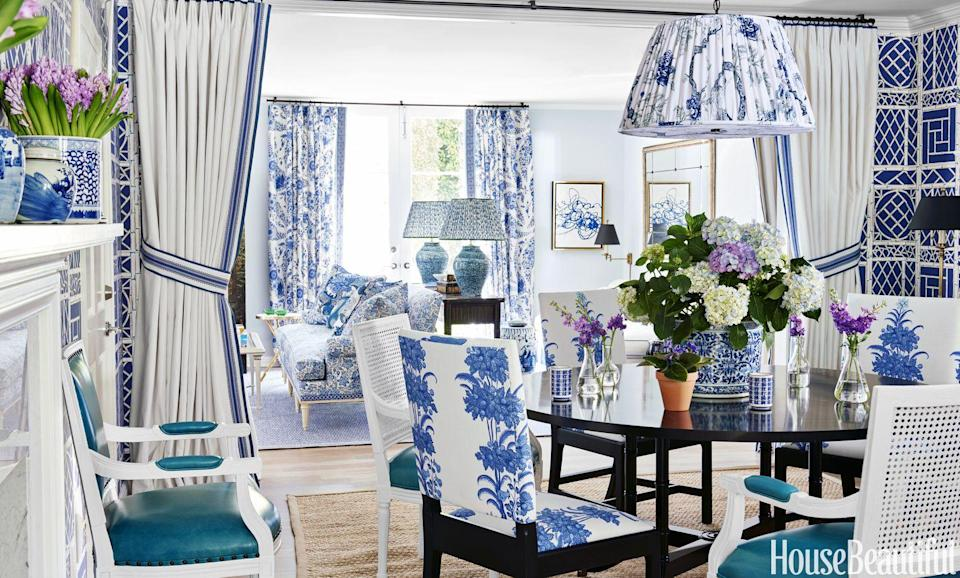 """<p>At a <a href=""""https://www.housebeautiful.com/design-inspiration/house-tours/g3878/mark-d-sikes-blue-white-house/"""" rel=""""nofollow noopener"""" target=""""_blank"""" data-ylk=""""slk:home in Beverly Hills,"""" class=""""link rapid-noclick-resp"""">home in Beverly Hills, </a>Mark D. Sikes used curtains in his go-to blue-and-white to turn an open concept into a dining and living space that are clearly delineated but visually connected. </p>"""