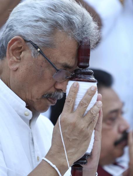 In this Aug 15, 2019, photo, former Sri Lankan Defense Secretary and opposition's presidential candidate Nandasena Gotabaya Rajapaksa prays at a Buddhist temple during his election campaign in Anuradhapura, Sri Lanka. Gotabaya is a feared former defense official accused of human rights abuses and crushing critics, but to many Sri Lankans, he is the leader most needed after last April's Easter bomb attacks that killed more than 250 people. (AP Photo/Sajeewa Chinthaka)