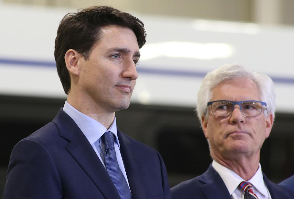 Canada's Prime Minister Justin Trudeau and Minister of International Trade Diversification Jim Carr visit the Winnipeg Transit Fort Rouge Garage as they make a transit infrastructure announcement in Winnipeg, Manitoba, Canada, February 12, 2019. REUTERS/Shannon VanRaes