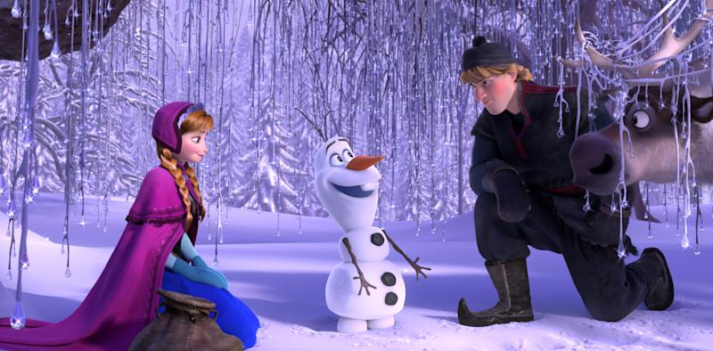 """This image released by Disney shows, from left, Anna, voiced by Kristen Bell, Olaf, voiced by Josh Gad, and Kristoff, voiced by Jonathan Groff in a scene from the animated feature """"Frozen."""" """"Frozen's"""" grip on the domestic box office is heading for a meltdown as the combat docudrama """"Lone Survivor"""" threatens a firefight for the top spot with an expected gross of $15 million. (AP Photo/Disney)"""