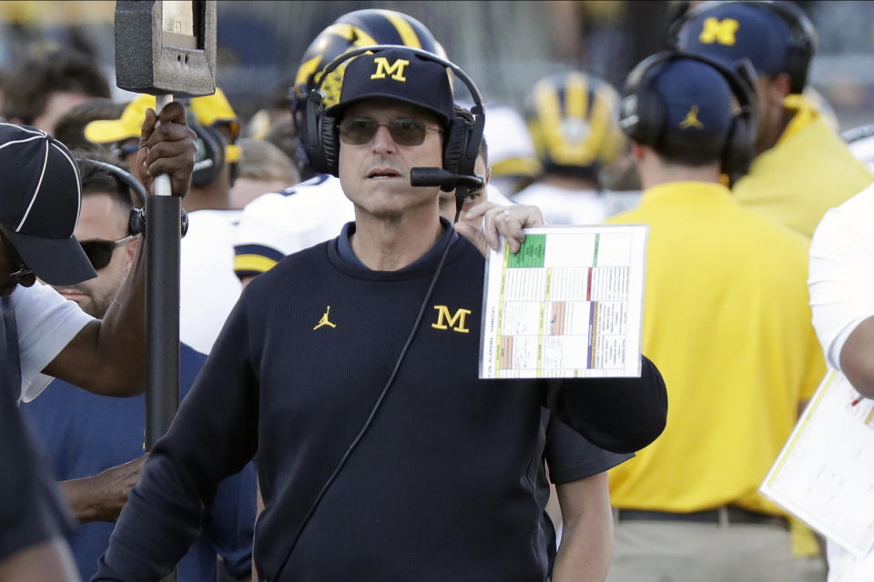 Michigan head coach Jim Harbaugh paces the sidelines during the second half of the Citrus Bowl NCAA college football game against Alabama, Wednesday, Jan. 1, 2020, in Orlando, Fla. (AP Photo/John Raoux)