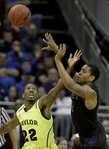 Kansas State guard Rodney McGruder, right, passes under pressure from Baylor guard A.J. Walton (22) during the first half of an NCAA college basketball game in the Big 12 Conference tournament, Thursday, March 8, 2012, in Kansas City, Mo. (AP Photo/Charlie Riedel)