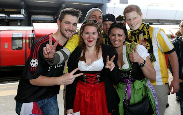 Borrussia Dortmund's and Bayern Munich's fans pose for a photograph at Wembley Park tube station before the Champions League Final at Wembley, London.