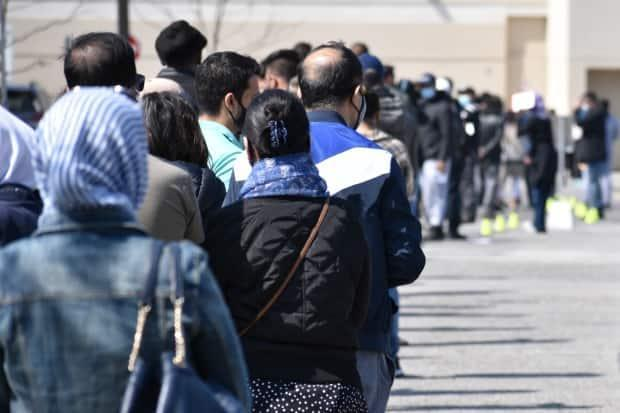 People line up at the East York Town Centre on Saturday, April 24. The clinic is open for people in Thorncliffe Park and Flemingdon Park for those who are over 18 years old.