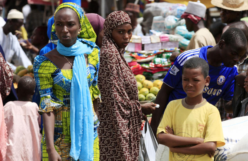 Women shop in a market in Maiduguri, Nigeria, Thursday, June 6, 2013. Maiduguri is the heart of Nigeria's Islamic insurgency. Military officials took journalists on a tour there Thursday, but largely declined to give specific answers about what's happening in the country's fight against the extremists. (AP Photo/Jon Gambrell)