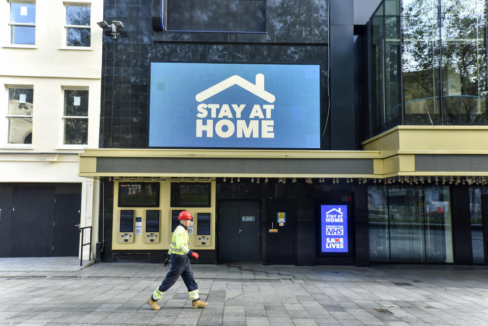 A man walking past the Odeon Luxe in Leicester Square where a digital screen showing a message saying 'Stay at home. England has entered into the 2nd Lockdown due to the Pandemic. (Photo by Dave Rushen / SOPA Images/Sipa USA)
