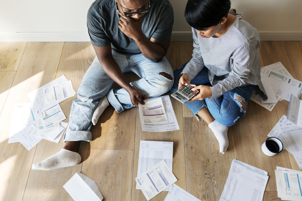 Couple managing debt. Source: Getty