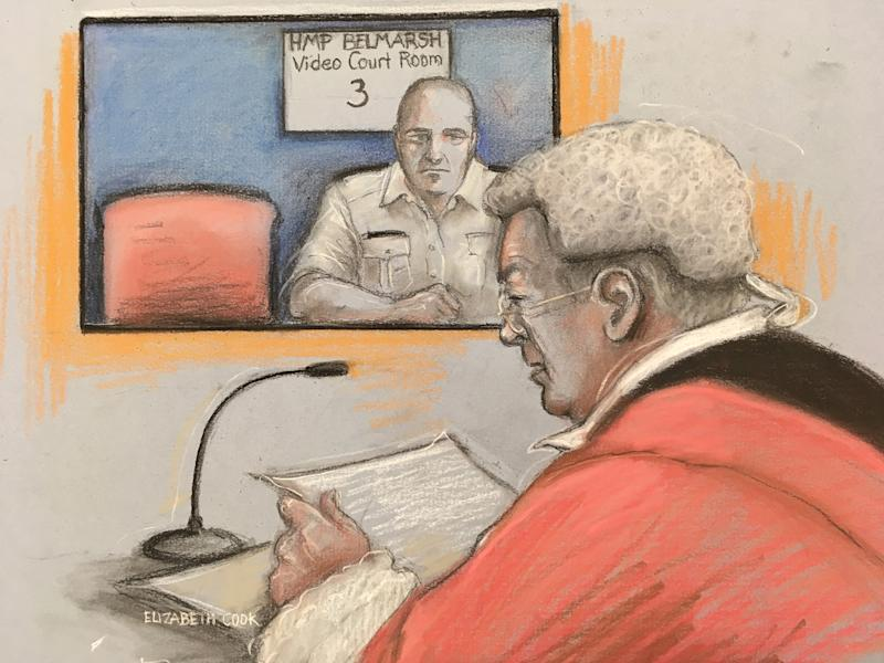 Court artist sketch by Elizabeth Cook of a prison guard sitting next to an empty chair at HMP Belmarsh after alleged serial sex attacker Joseph McCann refused to attend his plea hearing at the Old Bailey. The 34-year-old was due to appear before Mr Justice Edis via video-link from Belmarsh Prison on Thursday.