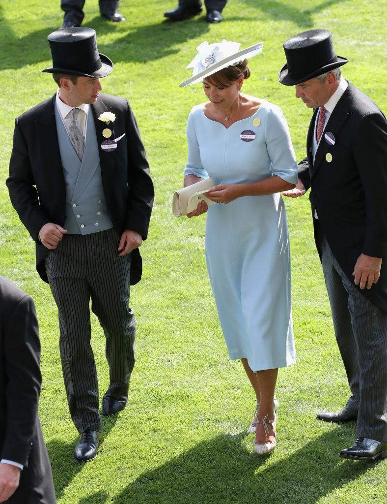 <p>It wasn't just the Windsor clan that put in an appearance. Kate's parents, Carole and Michael Middleton, also attended the festivities wearing their finest attire. <br><em>[Photo: Getty]</em> </p>