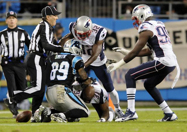 Officials separate Carolina Panthers' Steve Smith (89) and New England Patriots' Aqib Talib (31) during the first half of an NFL football game in Charlotte, N.C., Monday, Nov. 18, 2013. (AP Photo/Mike McCarn)