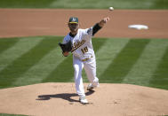 Oakland Athletics pitcher Cole Irvin (19) throws to a Detroit Tigers batter during the first inning of a baseball game on Saturday, April 17, 2021, in Oakland, Calif. (AP Photo/Tony Avelar)