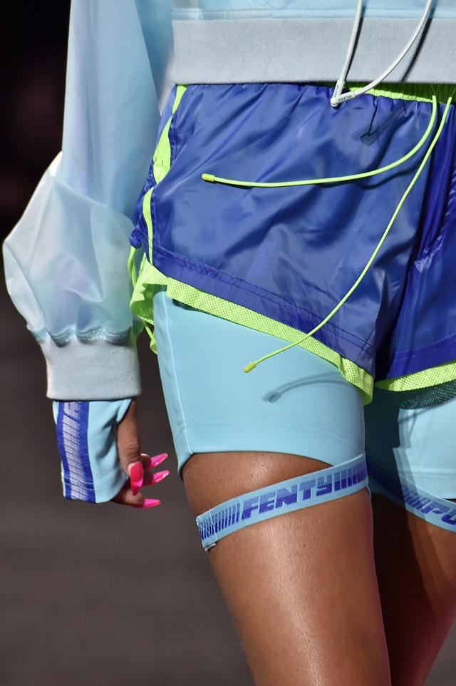 <p>Long, rectangle-shaped hot pink nails pop on the runway. (Photo by Victor VIRGILE/Gamma-Rapho via Getty Images) </p>