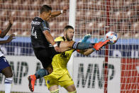 Vancouver Whitecaps goalkeeper Maxime Crepeau, rear, defends against Los Angeles Galaxy Chichartio (14) in the second half during an MLS soccer match Wednesday, June 23, 2021, in Sandy, Utah. (AP Photo/Rick Bowmer)