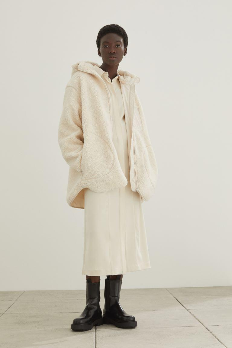<p>This <span>H&amp;M Hooded Faux Shearling Jacket</span> ($50) is perfect for fall. We want to cozy up in it all season long.</p>