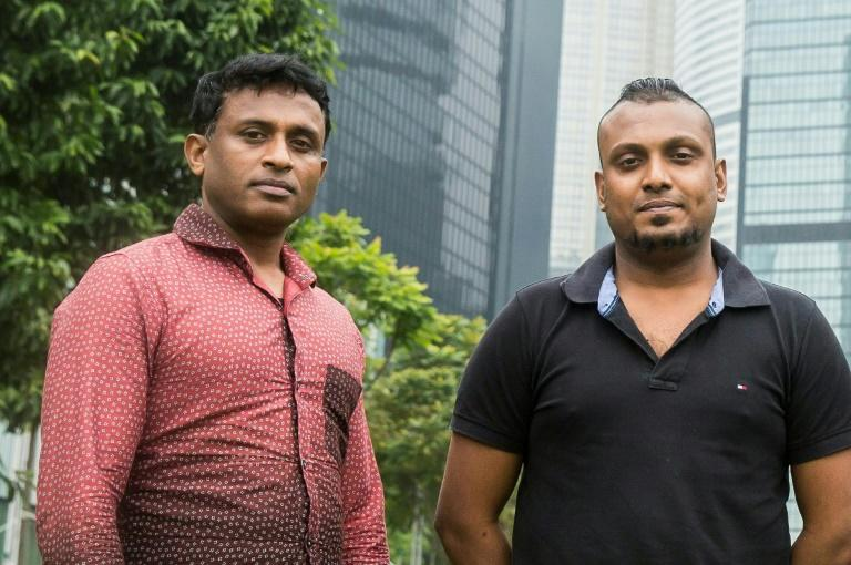 Sri Lankan refugees Ajith Puspa (left) and Supun Thilina Kellapatha pose for a photo in Hong Kong, on February 23, 2017