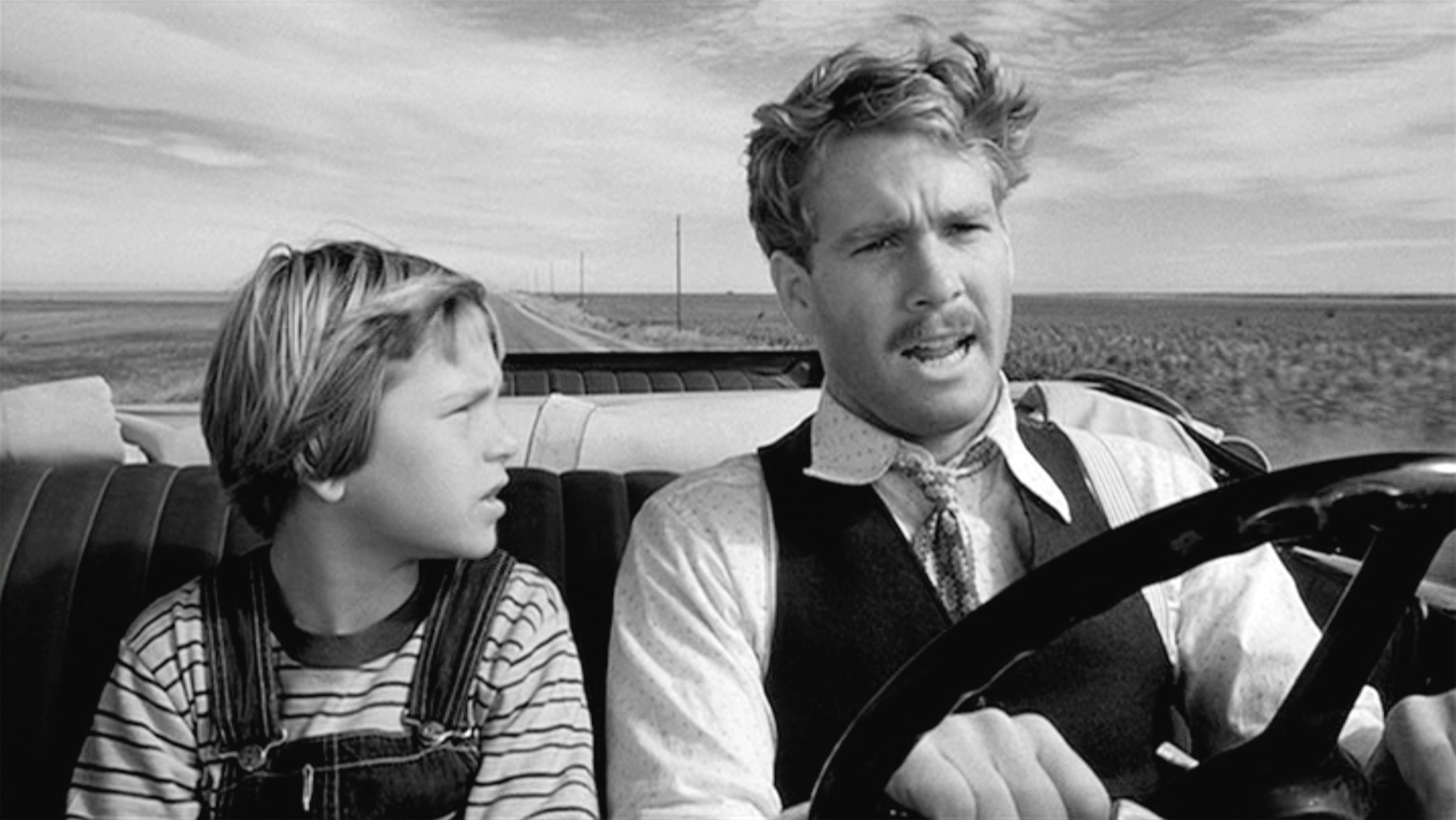Tatum O'Neal and Ryan O'Neal on screen in Paper Moon. (Photo: CBS via Getty Images)