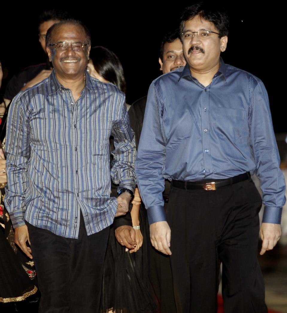 "Indian actor Rajinikanth (L) walks with Sun Network Managing Director Kalanidhi Maran (R) as they arrive for the Audio Launch of ""Enthiran"" at the Putrajaya International Convention Centre in Putrajaya on July 31, 2010. Enthiran, a forthcoming Tamil science fiction film, is currently the most expensive movie ever made in india. AFP PHOTO/MOHD RASFAN"