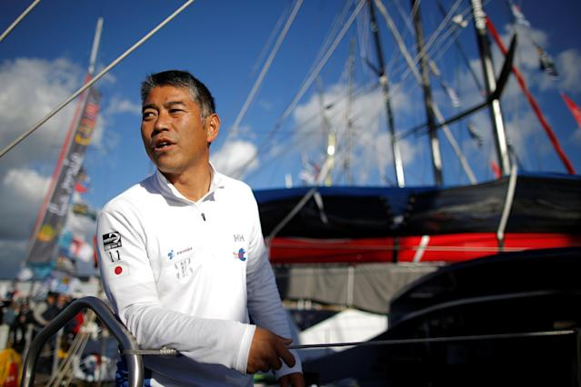 Skipper Kojiro Shiraishi of Japan poses on his monohull on the eve of the start of the Vendee Globe Challenge sailing race at Les Sables d'Olonne on France's Atlantic coast, western France, November 5, 2016. REUTERS/Stephane Mahe