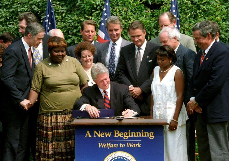 President Bill Cllinton signs a welfare reform bill that ends the 61-year-old federal guarantee of aid to the poor, August 22, 1996.