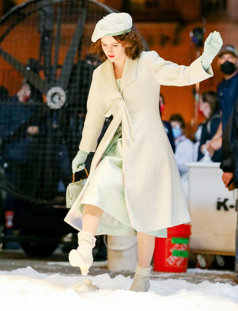 <p>Rachel Brosnahan is dressed for winter while filming an episode of <i>The Marvelous Mrs. Maisel </i>on June 24 in N.Y.C. </p>