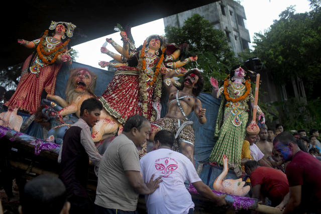 <p>Bangladeshi Hindu devotees carry an idol of Goddess Durga to immerse it on the last day of Durga Puja festival on the bank of the River Buriganga in Dhaka, Bangladesh, Saturday, Sept. 30, 2017. The festival commemorates the slaying of a demon king by lion-riding, ten-armed goddess Durga, marking the triumph of good over evil. (Photo: A.M. Ahad/AP) </p>