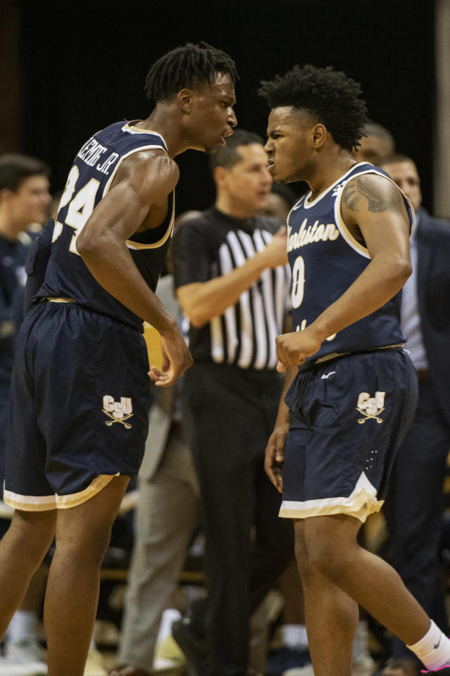Charleston Southern's Phlandrous Fleming Jr., left, and Travis Anderson, right, celebrate during the second half of an NCAA college basketball game against Missouri Tuesday, Dec. 3, 2019, in Columbia, Mo. Charleston Southern won the game 68-60. (AP Photo/L.G. Patterson)