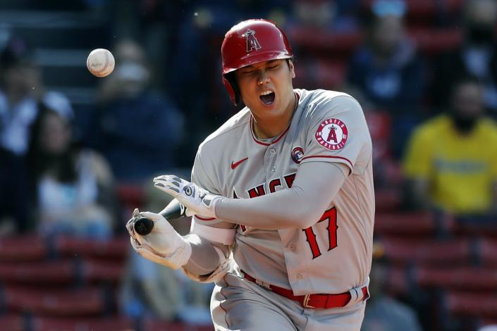 Los Angeles Angels' Shohei Ohtani fouls off during the third inning of a baseball game against the Boston Red Sox, Saturday, May 15, 2021, in Boston. (AP Photo/Michael Dwyer)