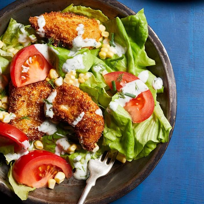 <p>A blend of whole-wheat panko and fine cornmeal gives this healthy chicken recipe the perfect amount of crunch even though it's not deep fried. Making an easy homemade buttermilk ranch dressing recipe means you can skip bottled, which may have additives and stabilizers.</p>