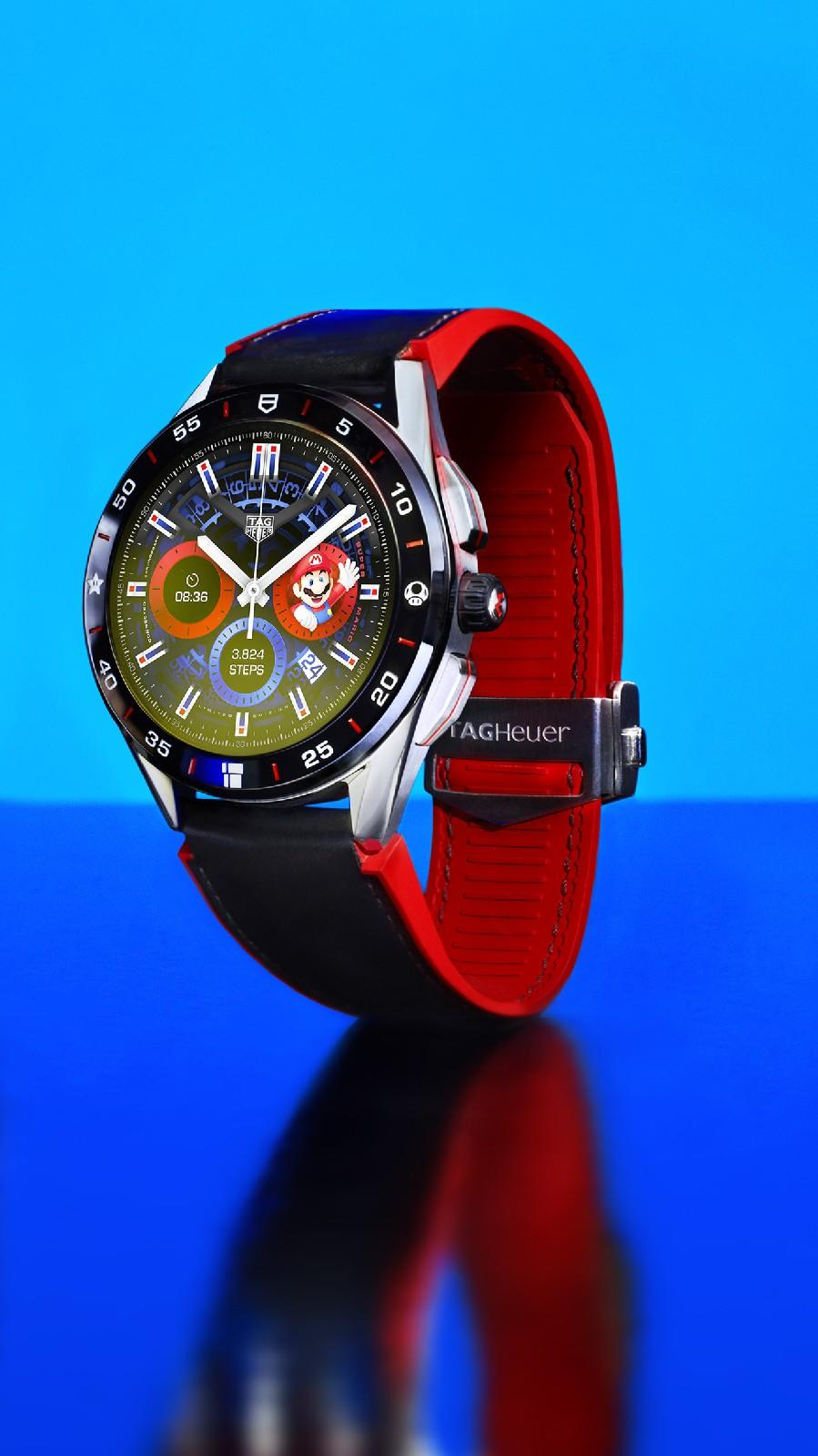 <p>Front view of the Tag Heuer Connected Limited Edition Super Mario with a black-and-red strap against a blue background.</p>