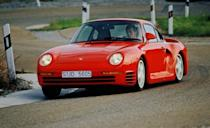 """<p>The coolest part of the single coolest car of the 1980s, the Porsche 959, was not its sequential turbos or its handful of Kevlar-reinforced body panels or its adjustable ride height or its six-speed manual (six speeds!) or its programmable four-wheel-drive system or its then-stratospheric 444 horsepower or even its ability <a href=""""http://www.caranddriver.com/reviews/porsche-959-archived-test-review"""" rel=""""nofollow noopener"""" target=""""_blank"""" data-ylk=""""slk:to perform miracles"""" class=""""link rapid-noclick-resp"""">to perform miracles</a> on demand <a href=""""http://blog.caranddriver.com/engineering-change-csaba-csere-recalls-testing-the-iconic-porsche-959"""" rel=""""nofollow noopener"""" target=""""_blank"""" data-ylk=""""slk:at the test track"""" class=""""link rapid-noclick-resp"""">at the test track</a>. The coolest thing about the 959 was that it proved to a generation of budding car nuts that intelligence could overcome brute force, that clever technology could win in the end. It was the thinking man's supercar. All the spoils needn't go to the suave and those with great hair. Is it any wonder that Bill Gates owned one?<br></p>"""