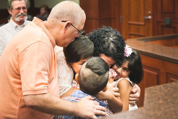 """""""This is the moment Jim and Jeanette's grandkids officially became their kids. The judge ruled in their favor and everyone in the courthouse cheered with them as they hugged and kissed one another. This was a hard-fought battle, and they were relieved it was finally over."""" -- Jennifer Hicks"""