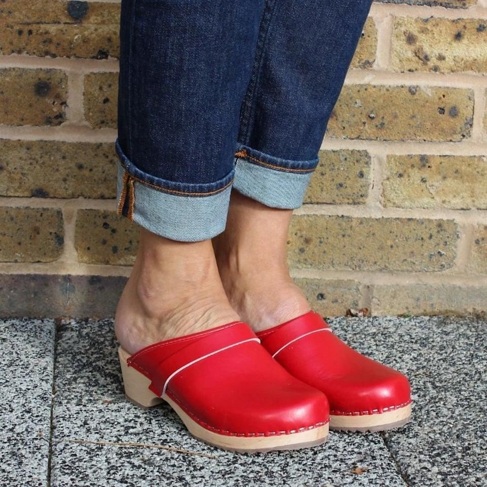 "<h2>Lotta From Stockholm Swedish Clogs</h2><br>While you'll often see clogs in muted natural tones like tan, brown, and black; we love a clodhopper in a nice, eye-catching hue — like this cherry-red pair from affordable footwear brand Lotta From Stockholm. (See also: a <a href=""https://www.etsy.com/listing/724456024/verka-clogs-swedish-wooden-clogs-for"" rel=""nofollow noopener"" target=""_blank"" data-ylk=""slk:patent-leather lace-front style"" class=""link rapid-noclick-resp"">patent-leather lace-front style</a> from Etsy clog merchant <a href=""https://www.etsy.com/shop/VerkaClogs"" rel=""nofollow noopener"" target=""_blank"" data-ylk=""slk:Verka"" class=""link rapid-noclick-resp"">Verka</a>.)<br><br><strong>Lotta From Stockholm</strong> Swedish Clogs, $, available at <a href=""https://go.skimresources.com/?id=30283X879131&url=https%3A%2F%2Fwww.etsy.com%2Flisting%2F821341297%2Fswedish-clogs-sweden-classic-red-pu"" rel=""nofollow noopener"" target=""_blank"" data-ylk=""slk:Etsy"" class=""link rapid-noclick-resp"">Etsy</a>"