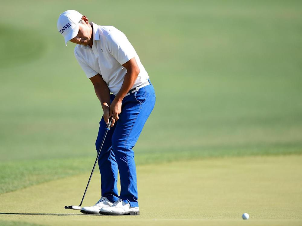 Sung Kang putts on the 18th green at the Houston Golf Club (Getty)