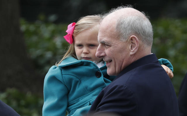 <p>White House Chief of Staff John Kelly holds a young girl in his arms during the annual White House Easter Egg Roll on the South Lawn of the White House in Washington, U.S., April 2, 2018. (Photo: Carlos Barria/Reuters) </p>