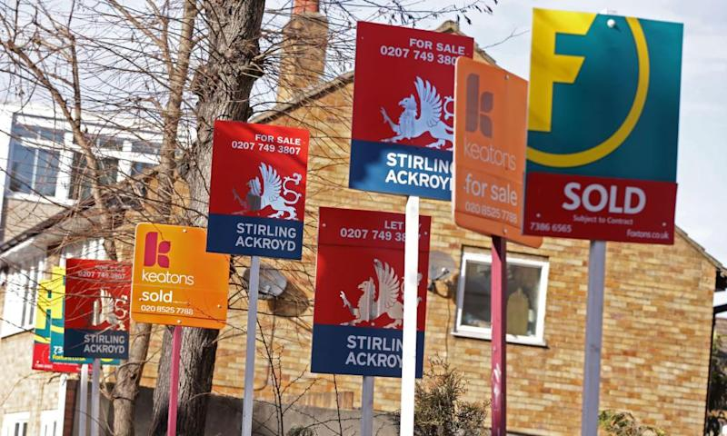 a row of Sold, For Sale and Let By signs displayed outside houses in London