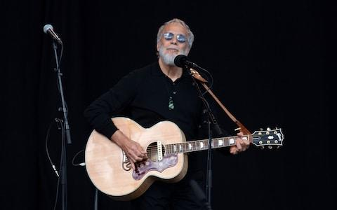 <span>Yusuf Islam, also known as Cat Stevens, sings during a national remembrance ceremony at North Hagley Park in Christchurch</span> <span>Credit: AFP </span>