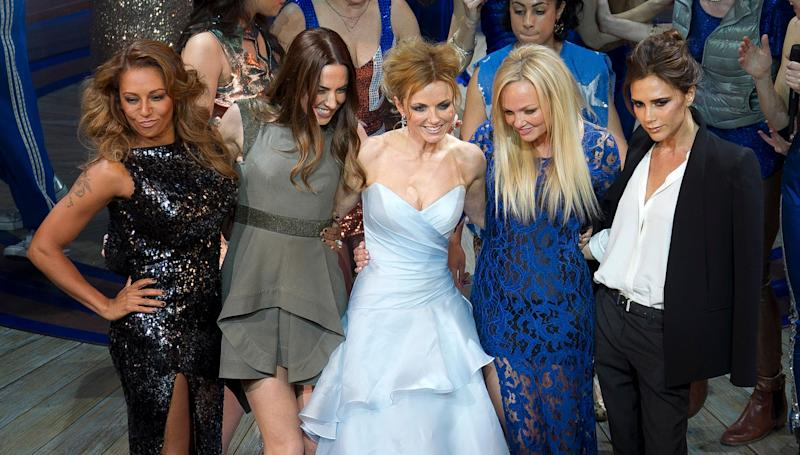 Mel B, from left, Mel C, Geri Halliwell, Emma Bunton, and Victoria Beckham take the applause on stage at the curtain call for Viva Forever! Press Night, a musical based on the songs of the Spice Girls, at the Piccadilly Theatre in central London, Tuesday, Dec. 11, 2012. (Photo by Joel Ryan/Invision/AP)