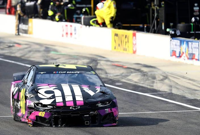 The No. 48 car of Justin Allgaier, leaves pit road banged up after being involved in a 6-car crash at Indianapolis Motor Speedway on Sunday.