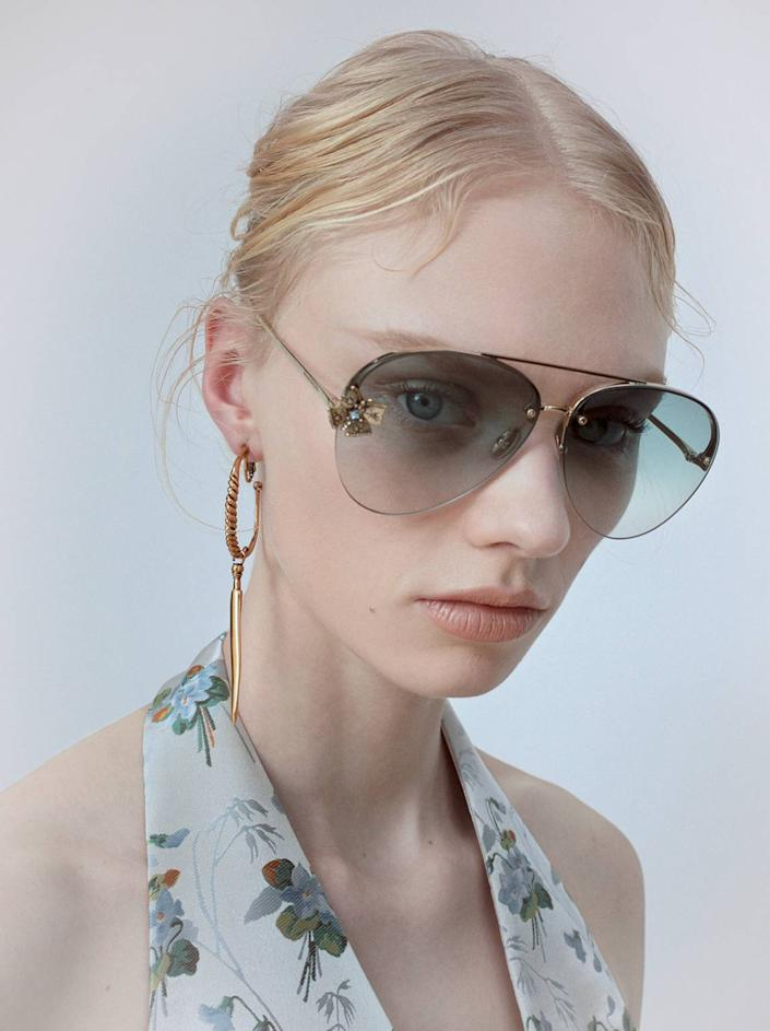 Visitors to the new Alexander McQueen flagship store can shop luxurious summer-ready accessories.