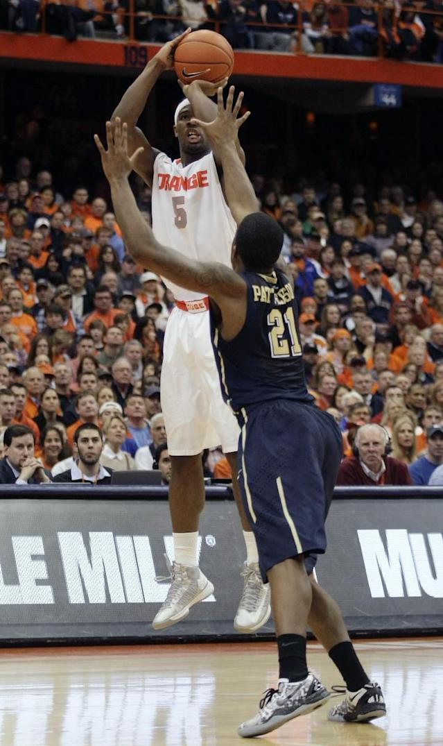 Syracuse's C.J. Fair, left, shoots over Pittsburgh's Lamar Patterson in the second half of an NCAA college basketball game in Syracuse, N.Y., Saturday, Jan. 18, 2014. Syracuse won 59-54. (AP Photo/Nick Lisi)
