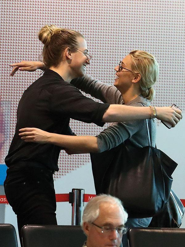 Christian Wilkins and Jasmine Yarbrough hug at Sydney's airport after Karl left solo. Source: Diimex