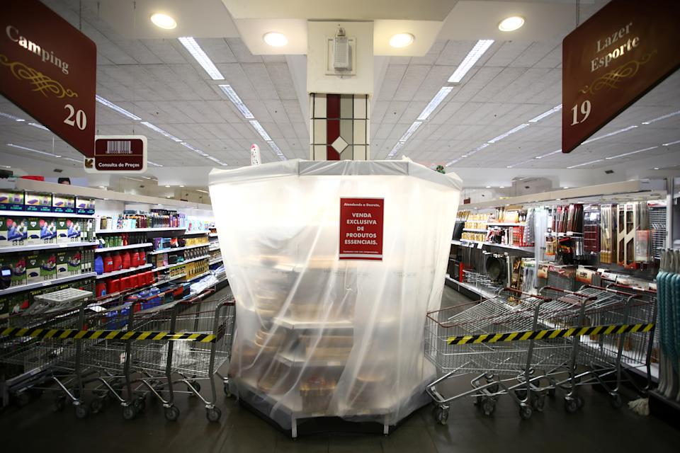 A shelf covered with plastic with non-essential products that are prohibited for sale is pictured at a supermarket, after the Rio Grande do Sul state government mandated further restrictions to curb the spread of coronavirus disease (COVID-19), in Porto Alegre, Brazil March 9, 2021. REUTERS/Diego Vara