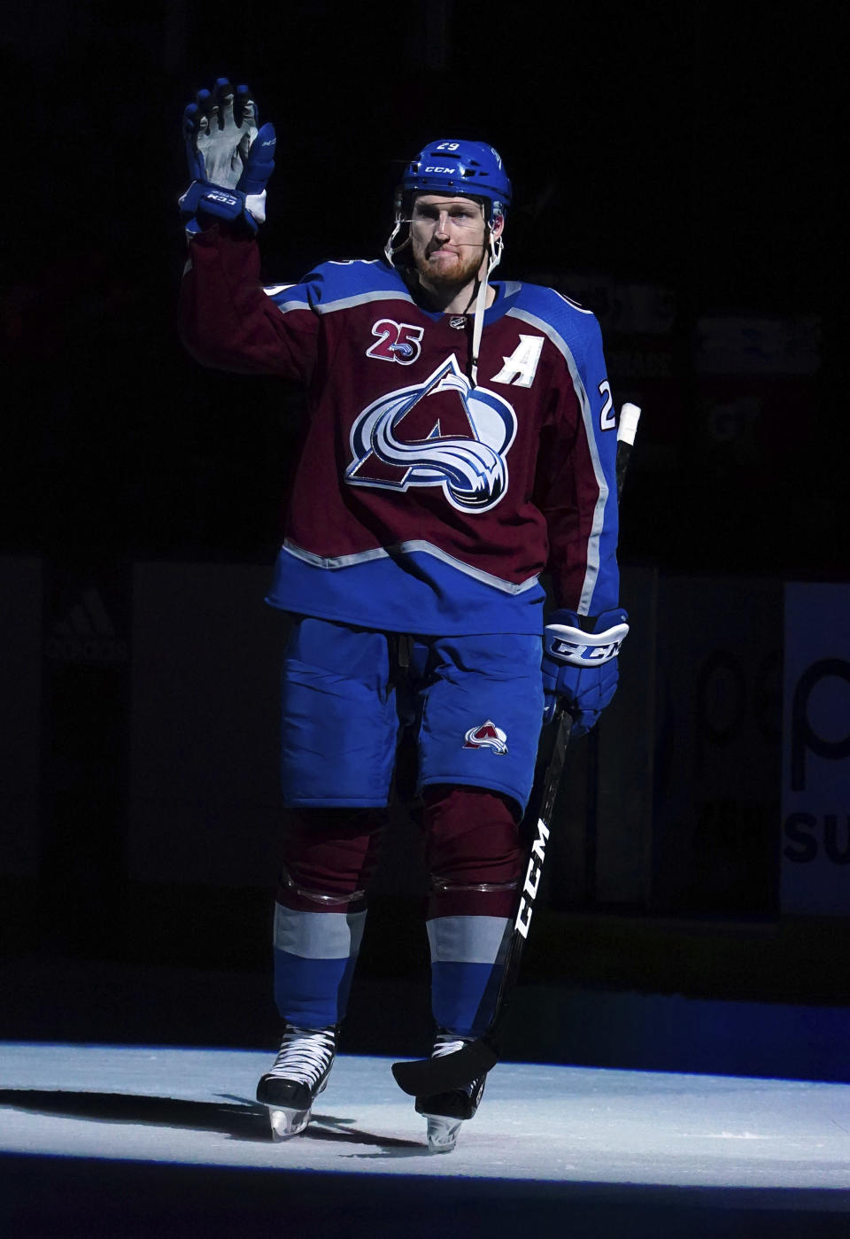 Colorado Avalanche center Nathan MacKinnon (29) waves to the crowd following a win against the Vegas Golden Knights in Game 1 of an NHL hockey Stanley Cup second-round playoff series Sunday, May 30, 2021, in Denver. (AP Photo/Jack Dempsey)