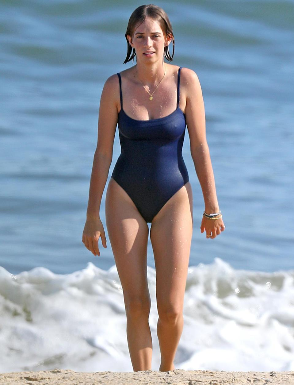 <p>Maya Hawke dons a blue one-piece for a dip on the beach in The Hamptons, New York, on Thursday.</p>