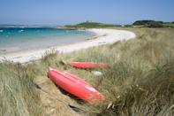"""<p>A great beach for watersports action, Old Grimsby is one of the loveliest beaches on Tresco. Grab a kayak and explore the turquoise waters of the dune-backed beach. You'll want to stop at beach cafe The Ruin for a bite to eat too.</p><p><strong>Country Living has an exclusive tour of the Isles of Scilly, taking in Tresco, Bryher, St Martin's and more as you explore the gardens and wildlife with top guide Will Wagstaff. </strong><a class=""""link rapid-noclick-resp"""" href=""""https://www.countrylivingholidays.com/tours/isles-of-scilly-will-wagstaff"""" rel=""""nofollow noopener"""" target=""""_blank"""" data-ylk=""""slk:FIND OUT MORE"""">FIND OUT MORE</a></p><p><strong>We want to keep you inspired. <a href=""""https://hearst.emsecure.net/optiext/optiextension.dll?ID=7YU7qVoYVtfwDQ9FRmu13FlJO1voc2zWFpXEkCOg3fHM93yYTOZhzXhAkCYFJ0k4z8Lej9Pfnfdp7K"""" rel=""""nofollow noopener"""" target=""""_blank"""" data-ylk=""""slk:Sign up"""" class=""""link rapid-noclick-resp"""">Sign up</a> for the latest travel stories and to hear about our financially protected holidays, for when the time is right. <a class=""""link rapid-noclick-resp"""" href=""""https://hearst.emsecure.net/optiext/optiextension.dll?ID=7YU7qVoYVtfwDQ9FRmu13FlJO1voc2zWFpXEkCOg3fHM93yYTOZhzXhAkCYFJ0k4z8Lej9Pfnfdp7K"""" rel=""""nofollow noopener"""" target=""""_blank"""" data-ylk=""""slk:SIGN UP"""">SIGN UP</a></strong></p>"""