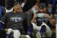 Los Angeles Dodgers celebrate after defeating the Tampa Bay Rays 3-1 to win the baseball World Series in Game 6 Tuesday, Oct. 27, 2020, in Arlington, Texas. (AP Photo/Eric Gay)