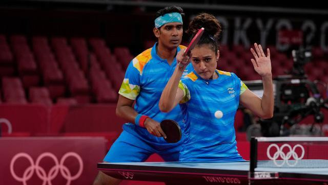 Achanta Sharath Kamal and Manika Batra in action during the table tennis mixed doubles event. AP